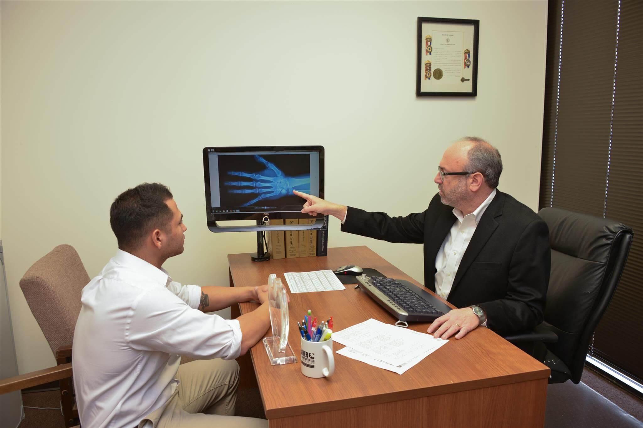 Doctor Explaining Broken write Xray